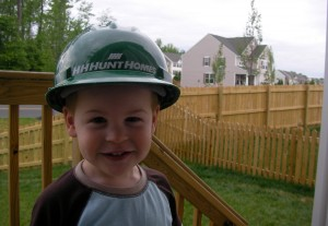 Little Boy Wearing HHHunt Homes Logo Hard Hat